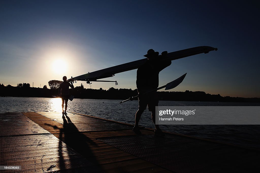 Athletes carry their boat from the water after warming up during day six of the Maadi Cup at Lake Karapiro on March 23, 2013 in Cambridge, New Zealand.