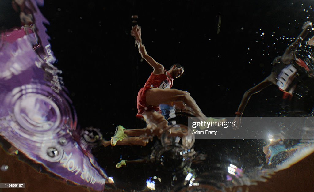 Athletes clear the water jump during the Men's 3000m Steeplechase Final on Day 9 of the London 2012 Olympic Games at the Olympic Stadium on August 5, 2012 in London, England.