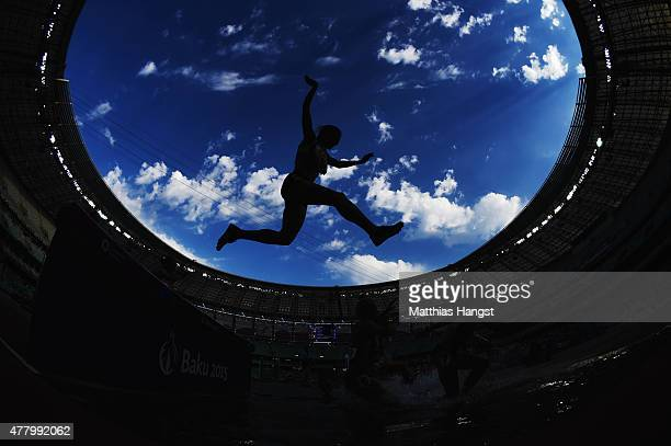 Athletes clear the water jump during the Women's 3000 metres steeplechase during day nine of the Baku 2015 European Games at the Olympic Stadium on...