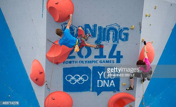 Athletes climb during show at the Sports Lab of the 2014 Youth Olympic Games in Nanjing in eastern China's Jiangsu province on August 17 2014 More...