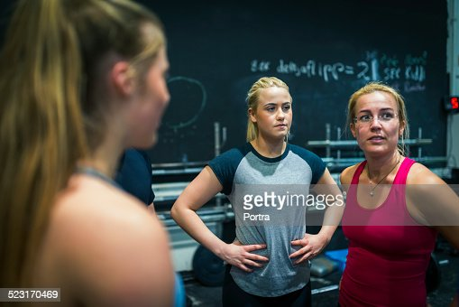Athletes communicating in fitness club