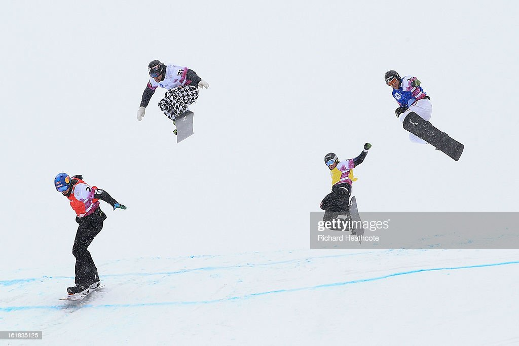Athletes compeate in poor visabilaty during the FIS World Cup Snowboard Cross competition at the Rosa Khutor Extreme Park in Krasnya Polyana on February 17, 2013 in Sochi, Russia. Sochi is preparing for the 2014 Winter Olympics with test events across the venues.