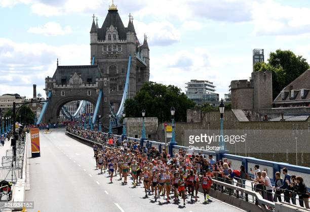 Athletes compete as they pass the Tower Bridge competes in the Women's Marathon during day three of the 16th IAAF World Athletics Championships...