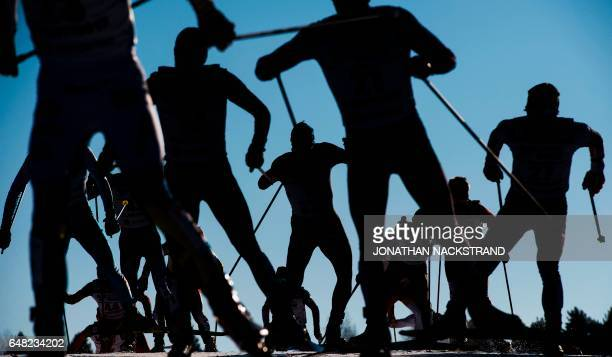 TOPSHOT Athletes compete at the men 50 km Mass Start Free event of the 2017 FIS Nordic World Ski Championships in Lahti Finland on March 5 2017 / AFP...