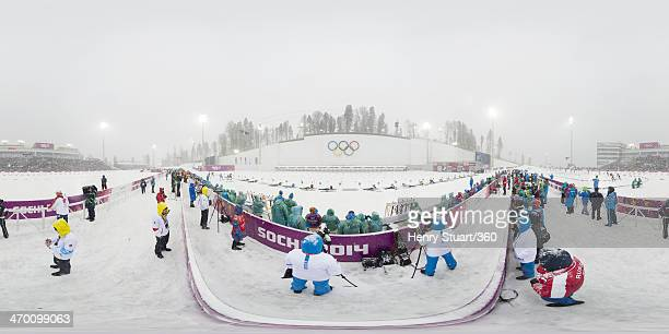 Athletes compete at the shooting range during the Men's 15 km Mass Start during day 11 of the Sochi 2014 Winter Olympics at Laura Crosscountry Ski...