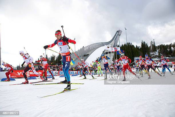 Athletes compete at the start of the IBU Biathlon World Cup Men's 15 kilometer Mass Start race on March 23 2014 in Oslo Norway