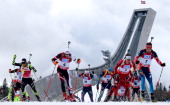 Athletes compete at the start of the IBU Biathlon World Cup Men's and Women's Mass Start on March 23 2014 in Oslo Holmenkollen Norway