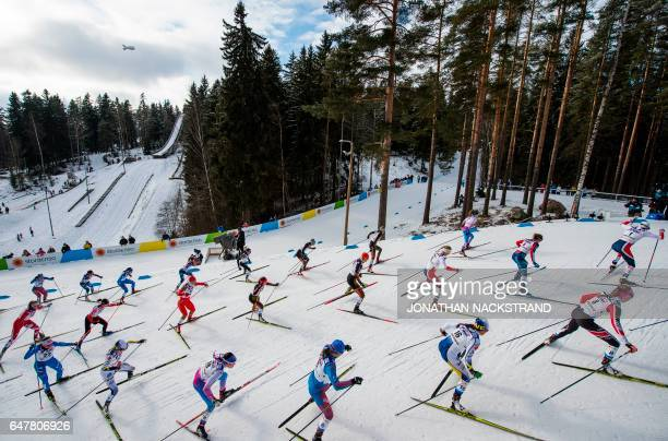 TOPSHOT Athletes compete at the women 30 km Mass Start Free event of the 2017 FIS Nordic World Ski Championships in Lahti Finland on March 4 2017 /...