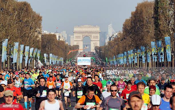 Athletes compete during the 39th Paris Marathon in Paris France on April 12 2015 Around 54000 competitors participated in the 39th edition of the...