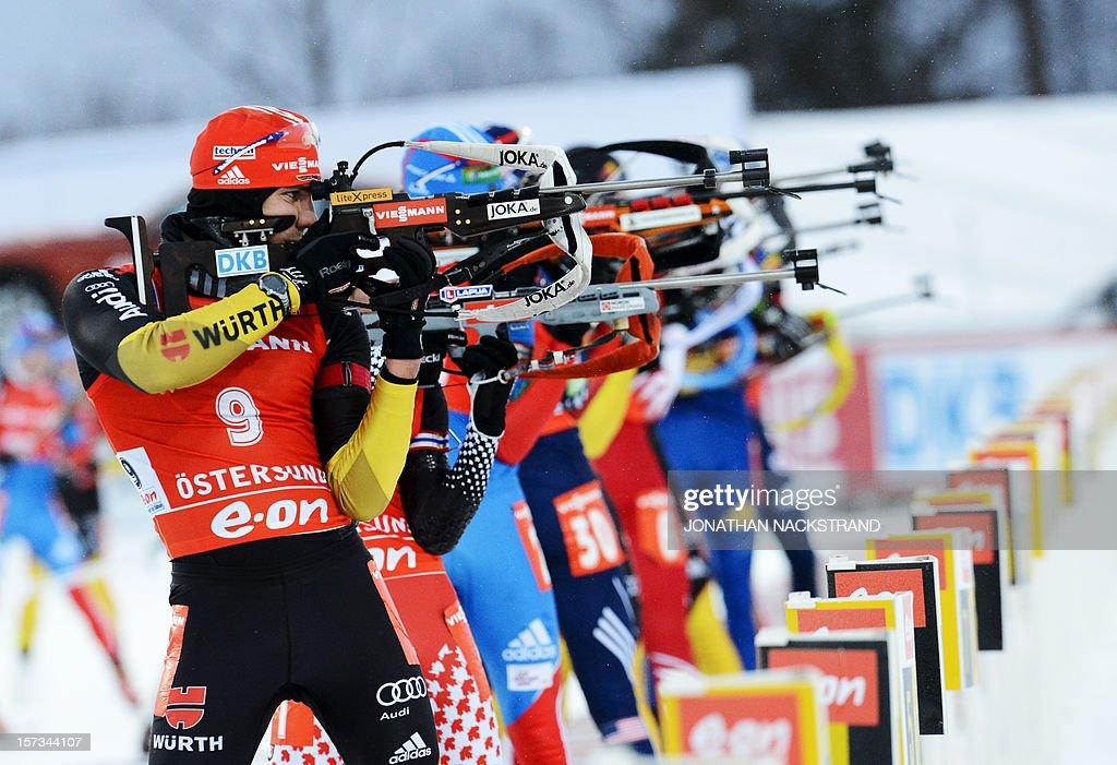 Athletes compete during the men's 12,5km pursuit race of the Biathlon World Cup in Ostersund on December 2, 2012. Martin Fourcade of France won the race ahead of Germany's Andreas Birnbacher (2nd) and Russia's Anton Shipulin (3rd). AFP PHOTO / JONATHAN NACKSTRAND