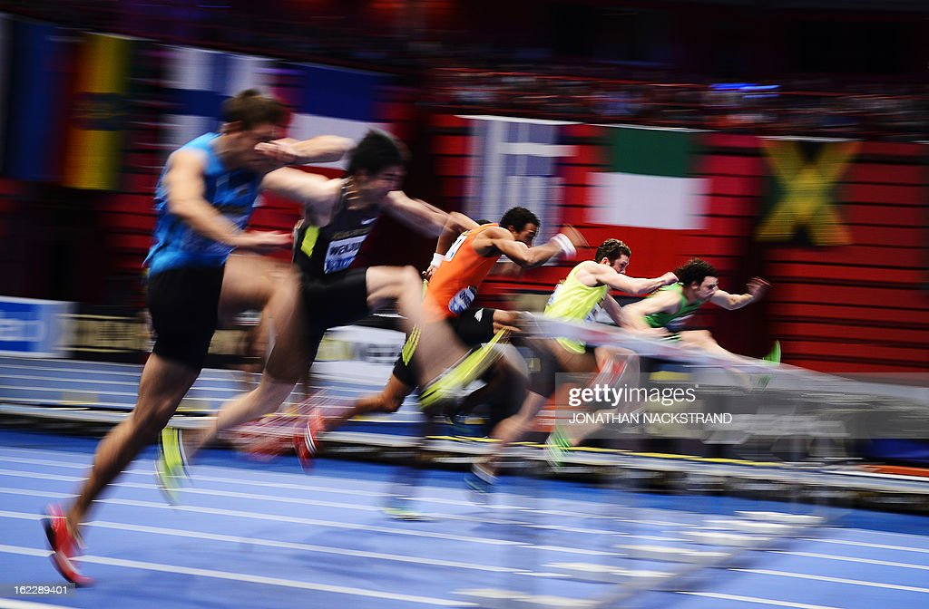 Athletes compete during the men's 60m hurdles event of the XL Galan Stockholm Athletics Indoor meeting on February 21, 2013 at the Ericsson Globe Arena in Stockholm.