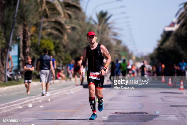 Athletes compete during the run leg of Ironman 703 Italy race on June 18 2017 in Pescara Italy