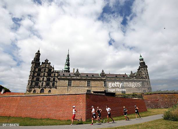 Athletes compete during the run section of Ironman 703 Kronborg on June 19 2016 in Helsingor Denmark