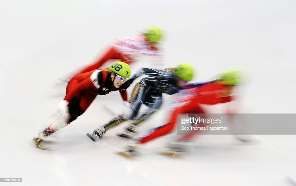Athletes compete during the Short Track Speed Skating on day 2 of the Vancouver 2010 Winter Olympics at Pacific Coliseum on February 13, 2010 in Vancouver, Canada.
