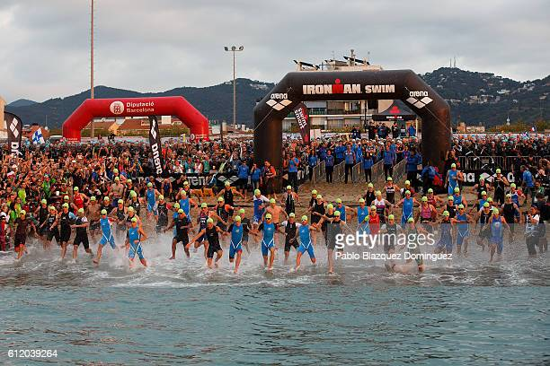 Athletes compete during the swim leg of Ironman Barcelona on October 2 2016 near Calella in Barcelona province Spain