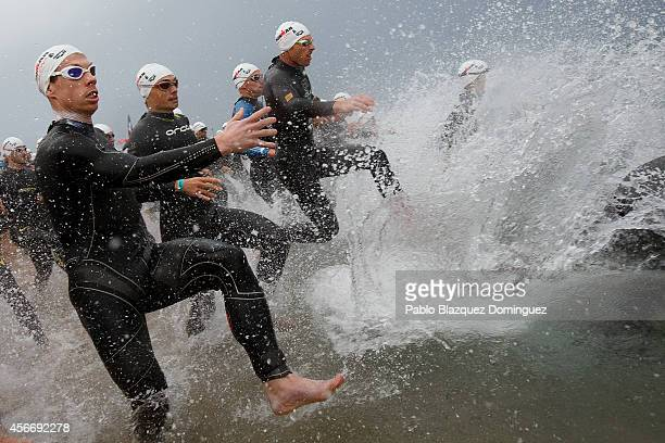 Athletes compete during the swim section of Ironman Barcelona on October 5 2014 in Calella city near Barcelona Spain