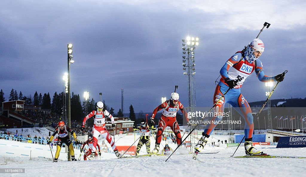 Athletes compete during the Women 10km Pursuit race of the Biathlon World Cup in Ostersund on December 2, 2012. AFP PHOTO/JONATHAN NACKSTRAND