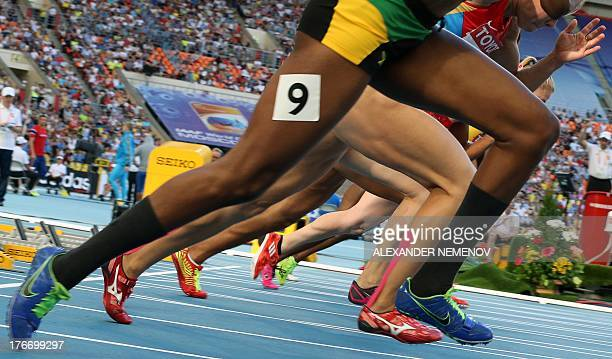 Athletes compete during the women's 100 metres hurdles semifinal at the 2013 IAAF World Championships at the Luzhniki stadium in Moscow on August 17...
