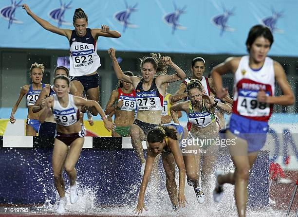 Athletes compete for the women's 3000 metres steeplechase during the 11th World Junior Championships at Chaoyang Sports Centre on August 15 2006 in...