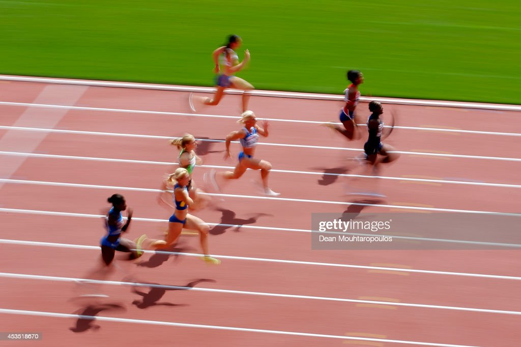 Athletes compete in competes in the Women's 100 metres heats during day one of the 22nd European Athletics Championships at Stadium Letzigrund on August 12, 2014 in Zurich, Switzerland.