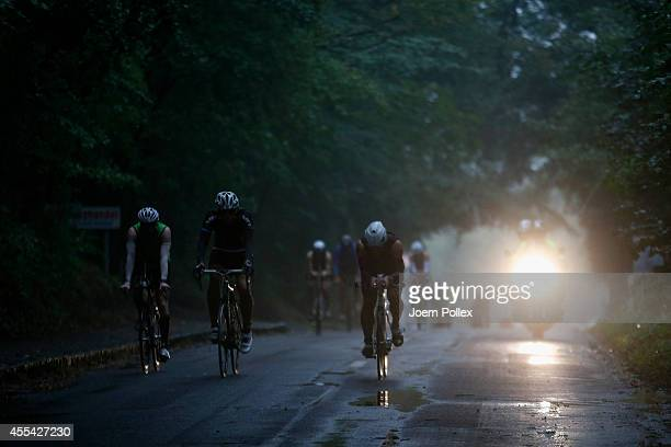 Athletes compete in the bike section during the Ironman 703 Ruegen on September 14 2014 in Binz Germany