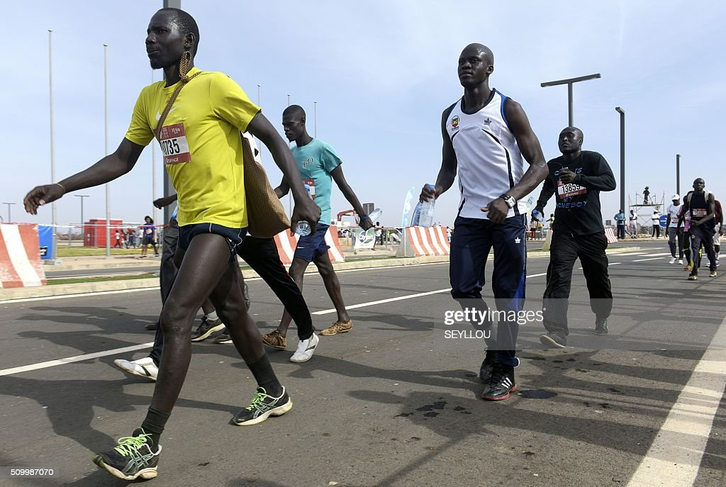 Athletes compete in the first ever Dakar International Marathon organised by the BTP Eiffage society on February 13, 2016 where thousands of people including numerous teenagers and children, took part in the two-day tournament. The competition started on February 13 in front of International Conference Center Abou Diouf (Cicad) on the outskirts of Dakar with different runs of 10 km and will end the day after, February 14, with a marathon. The BTP Eiffage society hosted the event to celebrates its 90 years of presence in Senegal. / AFP / SEYLLOU