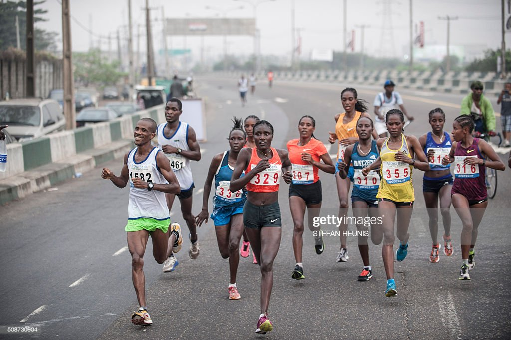 Athletes compete in the first Lagos City Marathon, on February 6, 2016 in Lagos. / AFP / STEFAN HEUNIS