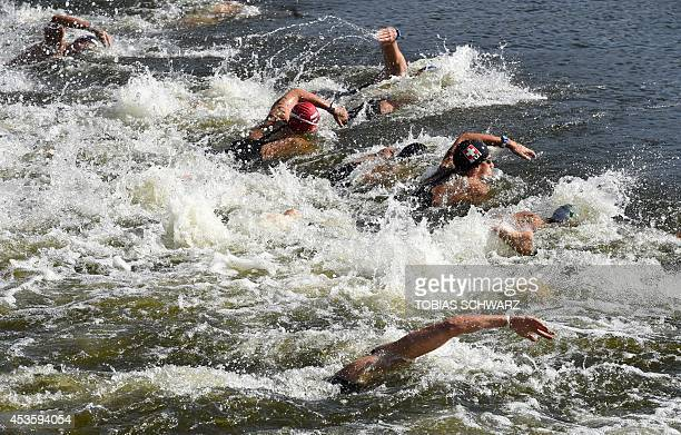 Athletes compete in the men's 10 km open water swimming event at the 32nd LEN European Swimming Championships on August 14 2014 at the Regattastrecke...