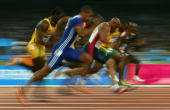 Athletes compete in the men's 100 metre semifinal on August 22 2004 during the Athens 2004 Summer Olympic Games at the Olympic Stadium in the Sports...