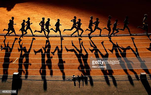 Athletes compete in the Men's 10000 metres final at Hampden Park during day nine of the Glasgow 2014 Commonwealth Games on August 1 2014 in Glasgow...