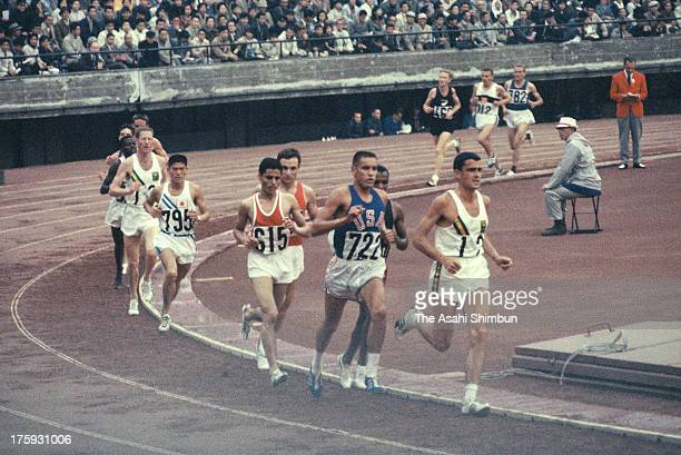 Athletes compete in the Men's 10000m at the National Stadium during the Tokyo Olympic on October 14 1964 in Tokyo Japan