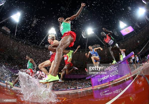 Athletes compete in the Men's 3000m Steeplechase during the Women's Marathon on Day 9 of the London 2012 Olympic Games on August 5 2012 in London...