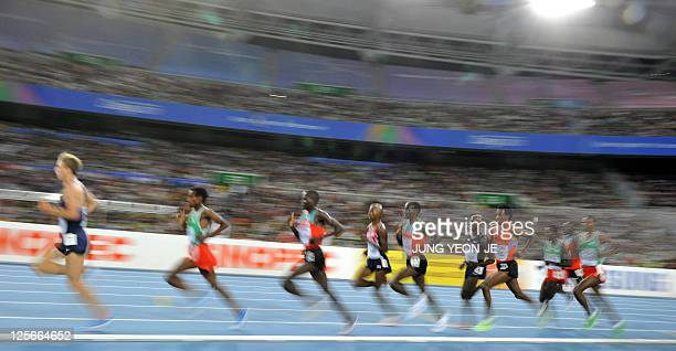 Athletes compete in the men's 5000 metres final at the International Association of Athletics Federations World Championships in Daegu on September 4...