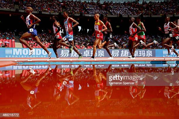 Athletes compete in the Men's 5000 metres heats during day five of the 15th IAAF World Athletics Championships Beijing 2015 at Beijing National...