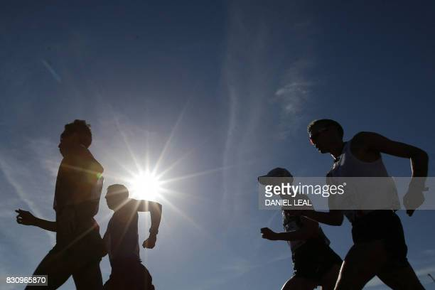 TOPSHOT Athletes compete in the men's 50km race walk athletics event at the 2017 IAAF World Championships on The Mall in central London on August 13...