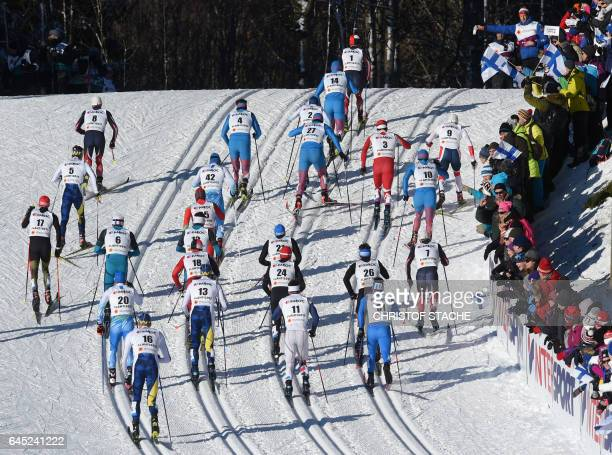 Athletes compete in the men's Skiathlon event of the 2017 FIS Nordic World Ski Championships in Lahti Finland on February 25 2017 / AFP / Christof...