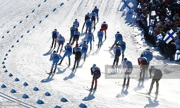 TOPSHOT Athletes compete in the men's Skiathlon event of the 2017 FIS Nordic World Ski Championships in Lahti Finland on February 25 2017 / AFP /...