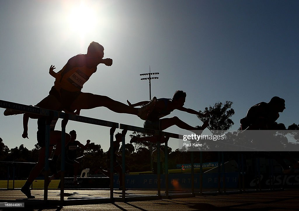 Athletes compete in the Men's under 20 110 metre hurdles final during day one of the Australian Junior Championships at the WA Athletics Stadium on March 12, 2013 in Perth, Australia.