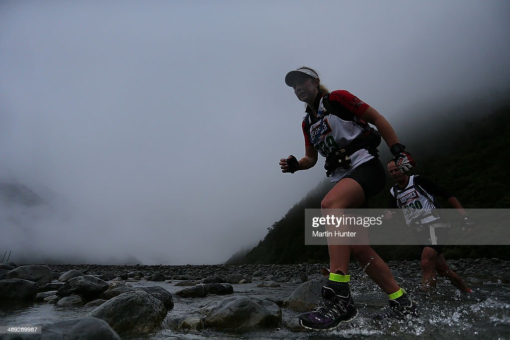 Athletes compete in the mountain run in the two day team event during the Speights Coast to Coast on February 14, 2014 in Christchurch, New Zealand.