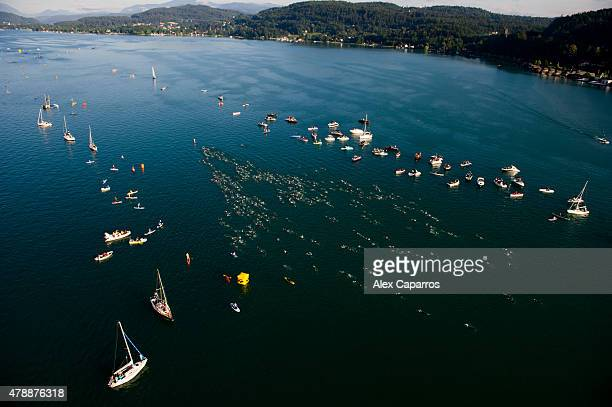 Athletes compete in the swim leg of the race during Ironman Klagenfurt on June 28 2015 in Klagenfurt Austria