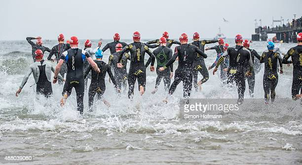 Athletes compete in the swimming of Ironman 703 Ruegen at Reugen Island on September 13 2015 in Stralsund Germany