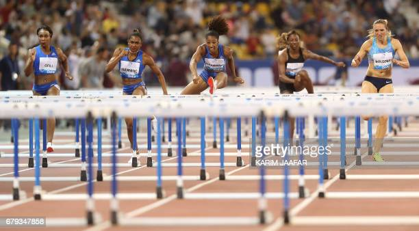 Athletes compete in the women's 100 metres hurdles during the Diamond League athletics competition at the Suhaim bin Hamad Stadium in Doha on May 5...