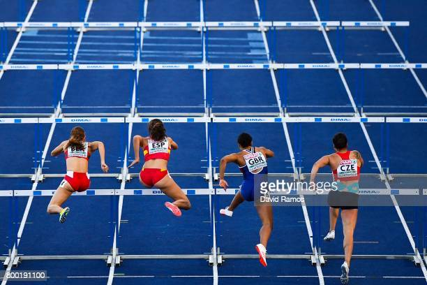 Athletes compete in the Women's 100m Hurdles heat 2 during day 1 of the European Athletics Team Championships at the Lille Metropole stadium on June...