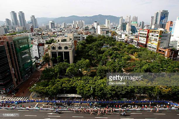 Athletes compete in the women's 20km race walk backdropped by the city skyline during day five of the 13th IAAF World Athletics Championships in...