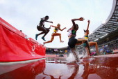 Athletes compete in the Women's 3000 metres Steeplechase at Hampden Park during day seven of the Glasgow 2014 Commonwealth Games on July 30 2014 in...