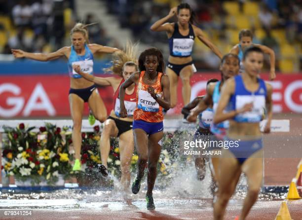 Athletes compete in the women's 3000 metres steeplechase during the Diamond League athletics competition at the Suhaim bin Hamad Stadium in Doha on...
