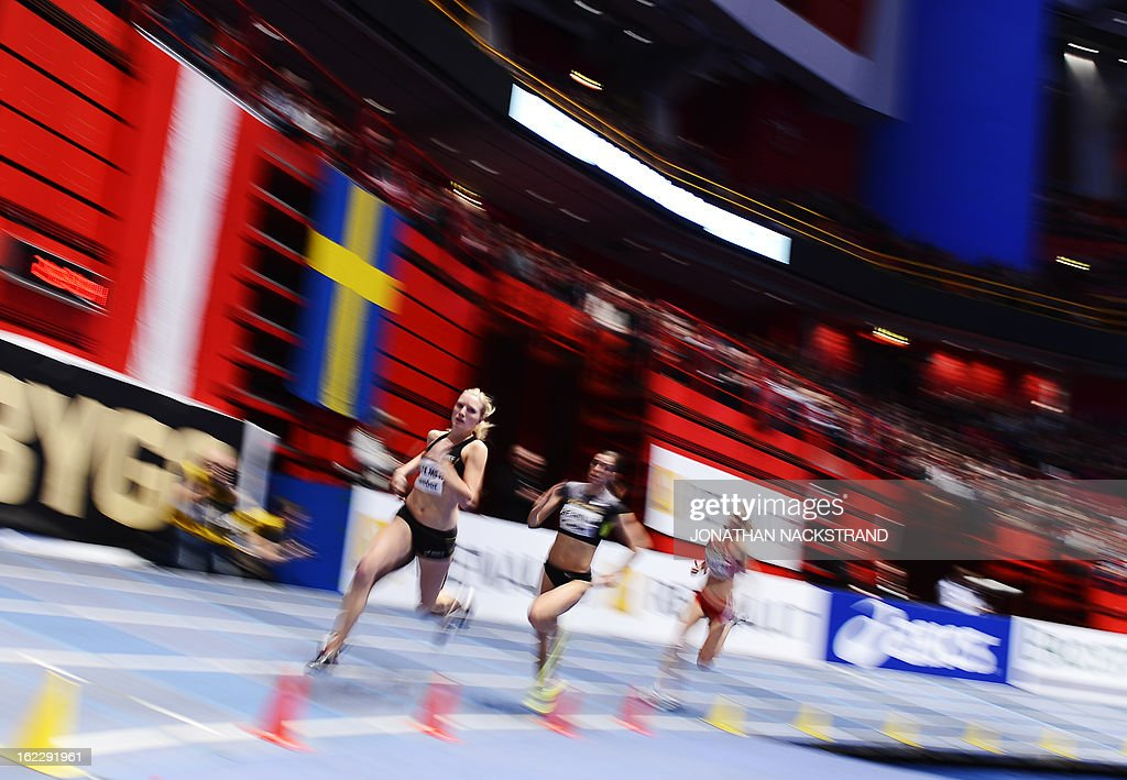 Athletes compete in the women's 400m event during the XL Galan Stockholm Indoor Athletics meeting on February 21, 2013 at the Ericsson Globe Arena in Stockholm.