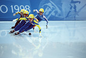 Athletes compete in the women's 500m short track speed skating final at White Ring during the 1998 Winter Olympic games