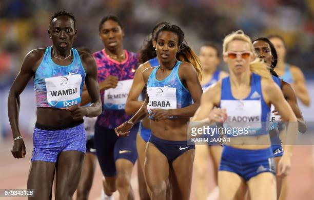 Athletes compete in the women's 800 metres during the Diamond League athletics competition at the Suhaim bin Hamad Stadium in Doha on May 5 2017 /...