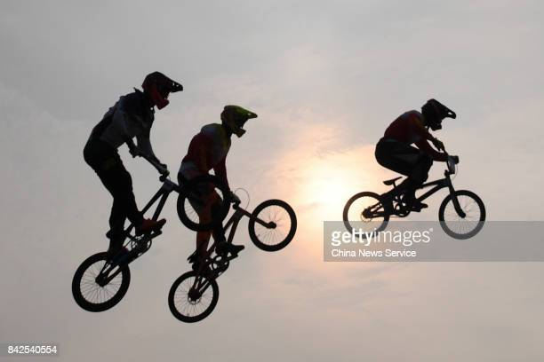 Athletes compete in the Women's BMX cycling event of the 13th Chinese National Games at Tianjin Tuanbo sport center on September 4 2017 in Tianjin...